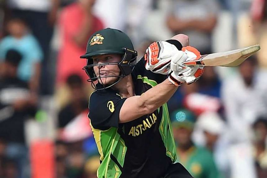 (Above) Australian captain Steve Smith hit 61 to rescue his side from a shaky start after the loss of three early wickets.