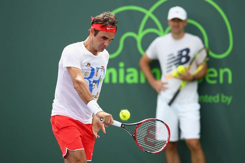 Roger Federer being watched by coach Ivan Ljubicic during practice at the Miami Open. He was due to face former US Open champion Juan Martin del Potro, who is also on the comeback trail, yesterday.