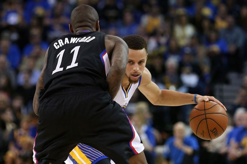 Golden State's Stephen Curry taking on Los Angeles Clippers' Jamal Crawford in Oakland on Wednesday. The Warriors' 114-98 win was their 51st consecutive regular-season home victory and improved their mark to 64-7.