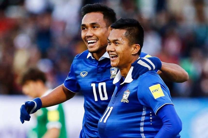 Thailand's Mongkol Thosakrai (right) celebrating the opener with Teerasil Dangda in the World Cup qualifier against Iraq that ended 2-2 in Teheran on Thursday.