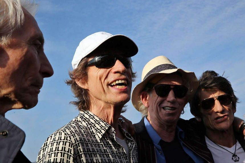 The Rolling Stones (from left) Charlie Watts, Mick Jagger, Keith Richards and Ronnie Wood arrive in Havana, Cuba, March 24, 2016.
