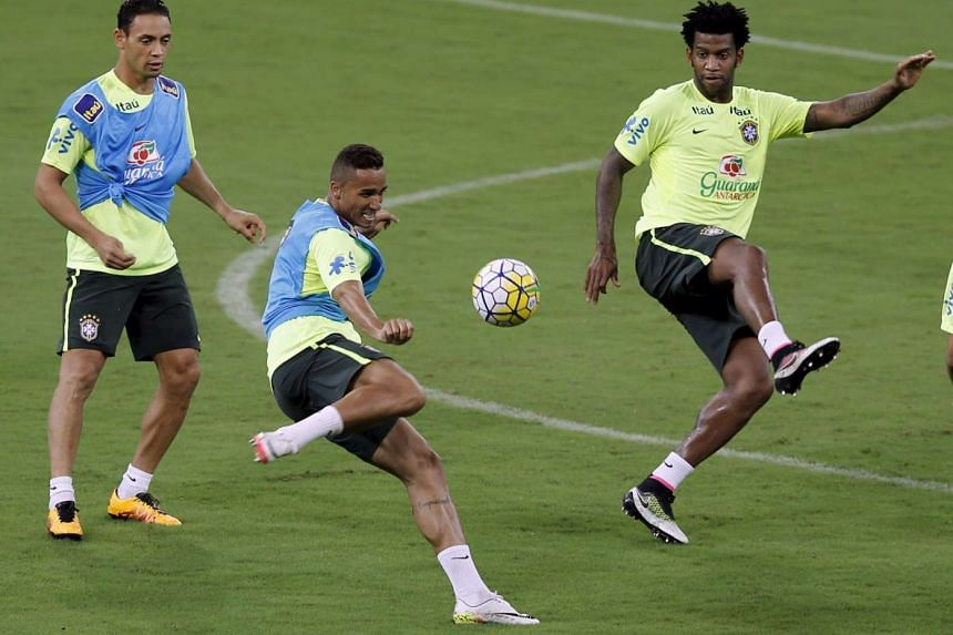 (From left) Brazil's Ricardo Oliveira, Danilo and Gil training before their World Cup 2018 qualifier football match against Uruguay.