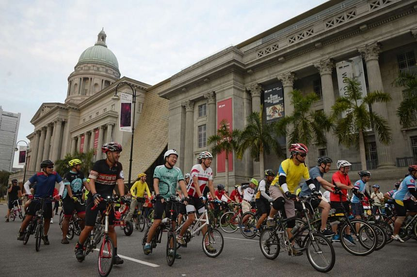 Cyclists ride along St Andrew's Road in front of the National Gallery during Car-Free Sunday on March 27, 2016.