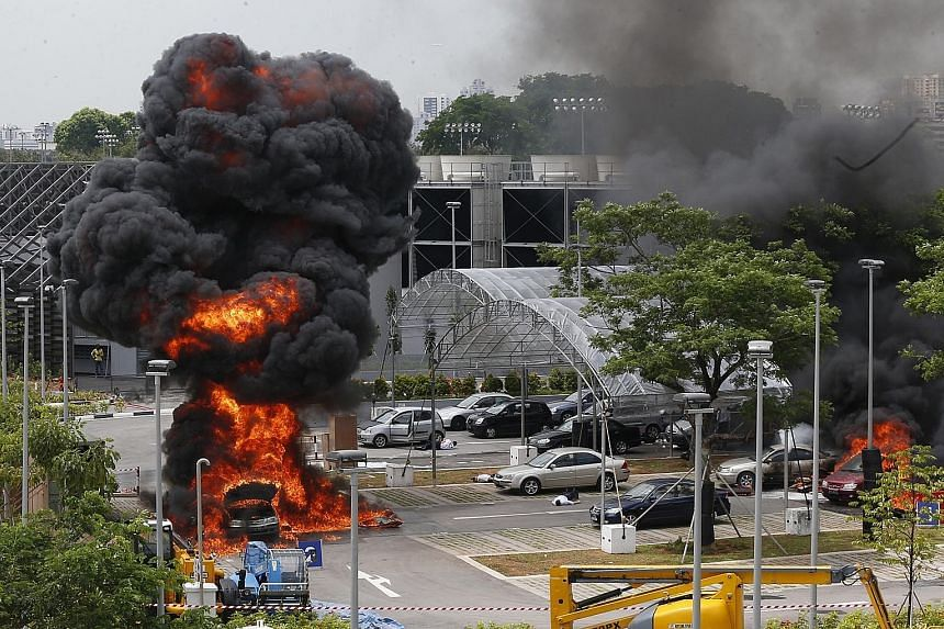 "Two cars burst into flames outside the Singapore Sports Hub on April 30 last year in a staged ""terror attack"" to test the response of the country's emergency services. Around 35 per cent of those surveyed wondered if citizens had the heartware to dea"