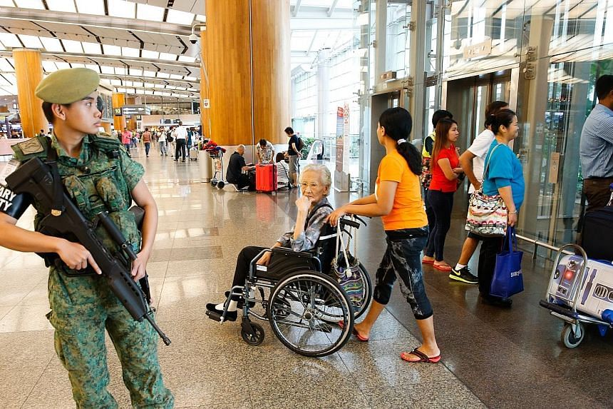 """Since the Brussels attacks, patrols have been stepped up at key installations like transport nodes, including Changi Airport (above) and MRT stations (below). Security experts have suggested measures like setting up random checkpoints as a """"visual de"""