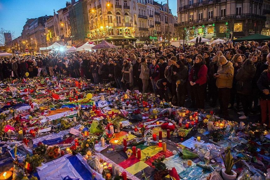 Muslims showing solidarity with other Belgians at the Place de la Bourse. Amid the grief, there is fear among the sizeable Muslim community in Brussels of a backlash that could make integration even harder than it is. Belgians holding prayers in the