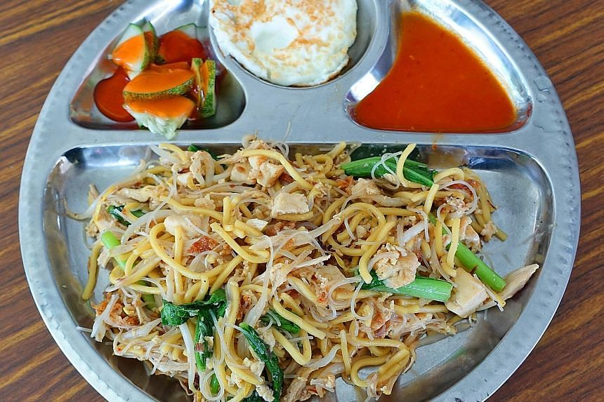 The Indian Hokkien Mee comes with slivers of chicken and cubes of firm tofu.