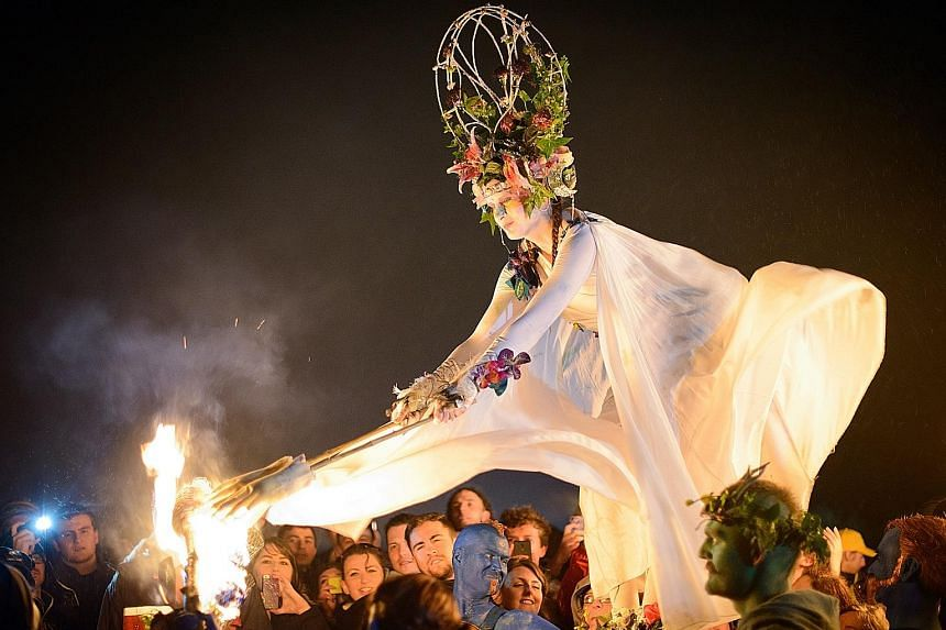 Land dives at Pentecost Island in Vanuatu (left) and the May Queen (above) at the annual Beltane Fire Festival in Edinburgh, Scotland.