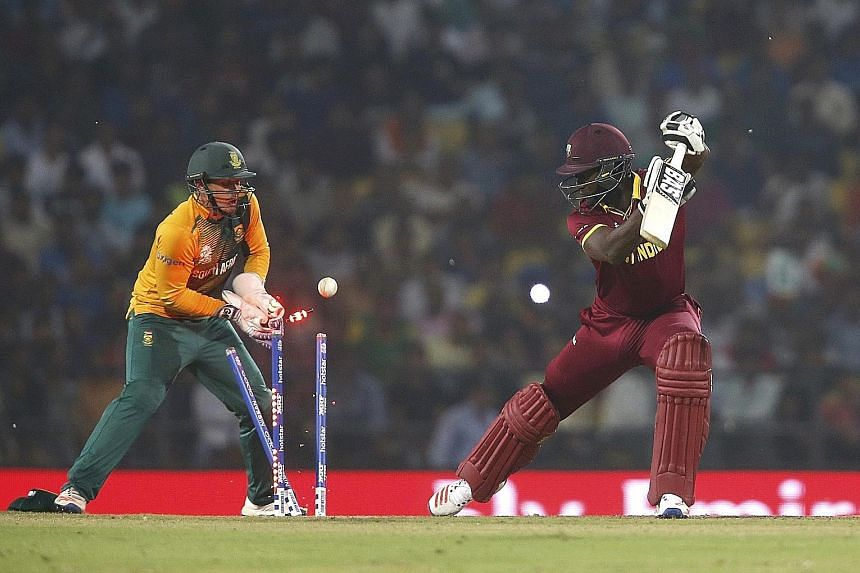 West Indies captain Darren Sammy is bowled by South Africa's Imran Tahir for a duck, leaving his side at 100-6 while chasing a target of 123. The West Indies eventually won the World Twenty20 match in Nagpur by three wickets with two balls remaining.