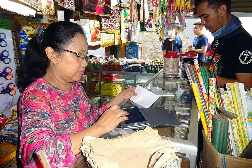 """Madam Maihar, who runs a small provision shop in Jakarta, made the plunge into cyberspace four months ago when she was introduced to Kudo, a local tech start-up which allows """"agents"""" like her to sell clothes and concert tickets from its merchant part"""