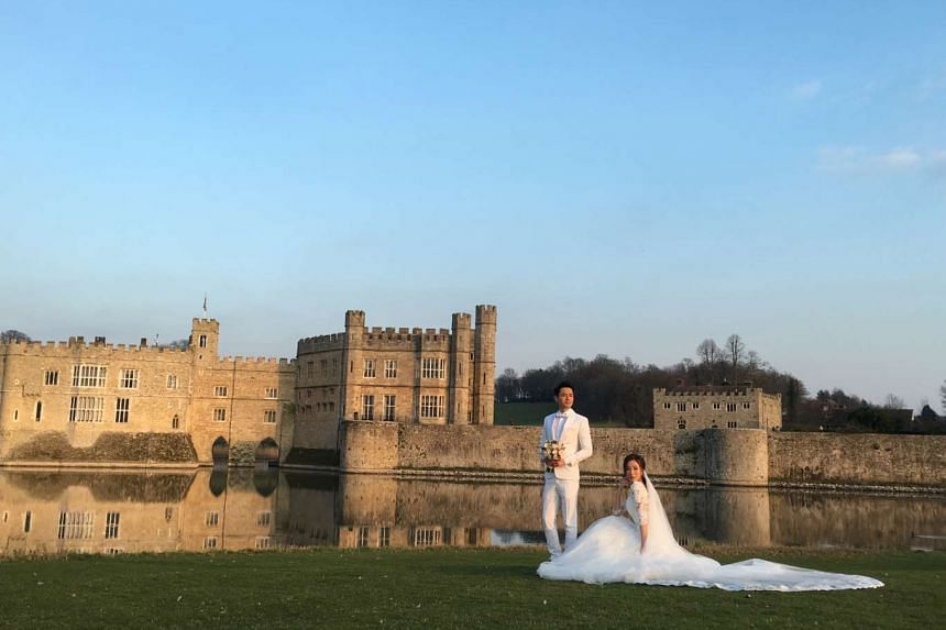 TVB actors Tavia Yeung (right) and Him Law posing for a wedding photo in front of Leeds Castle in England.