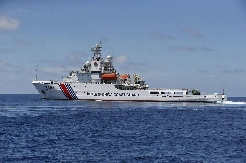 A Chinese Coast Guard vessel is pictured on the disputed Second Thomas Shoal, part of the Spratly Islands, in the South China Sea on March 29, 2014.