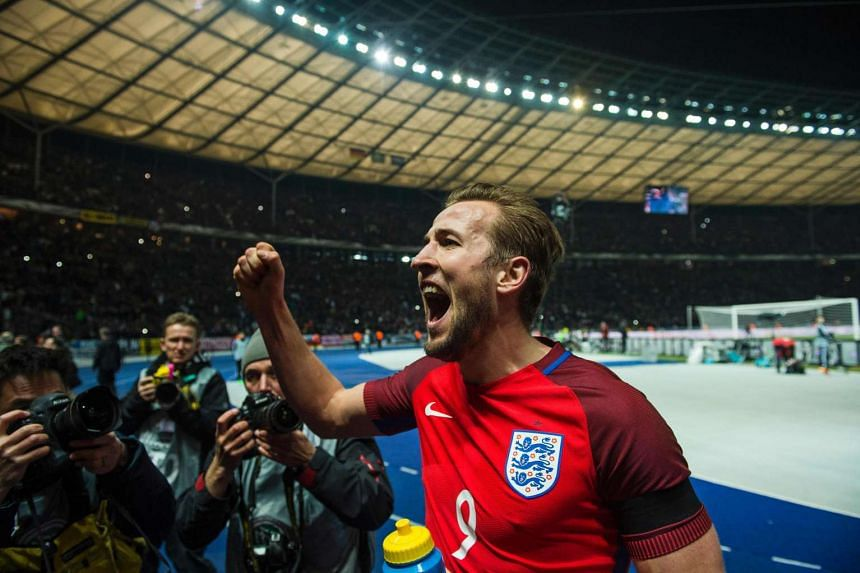 England's striker Harry Kane acknowledges the travelling fans at the end of the match.