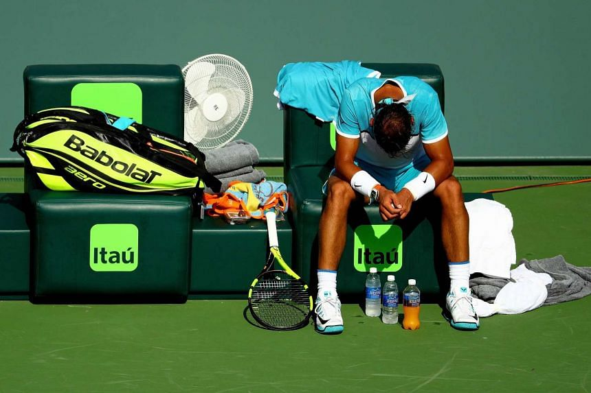 Nadal waits for a doctor before retiring.