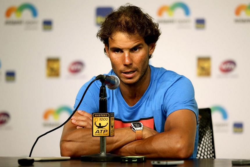 Rafael Nadal of Spain fields questions from the media after retiring from his match during the Miami Open, on March 26, 2016.