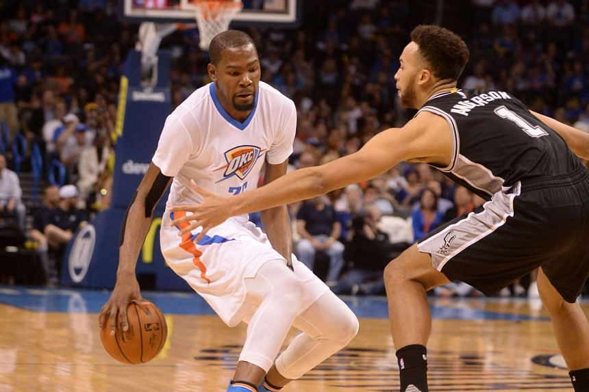 Oklahoma City Thunder forward Kevin Durant (left) handles the ball in front of San Antonio Spurs forward Kyle Anderson during their game at Chesapeake Energy Arena.