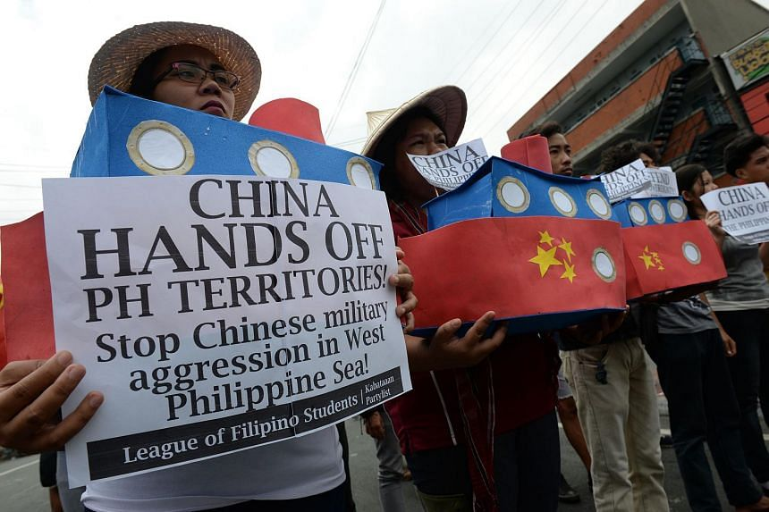 Filipino students shout anti-Chinese slogans during a rally near Malacanang Palace in Manila, on March 3, 2016.