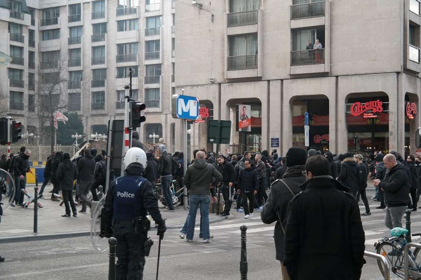 Rioters confront police near Place de la Bourse, who used cannons and pepper spray on them.