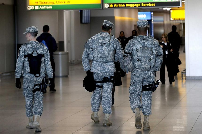 US Army security officers patrol inside New York's John F. Kennedy International Airport in New York, on March 22, 2016.