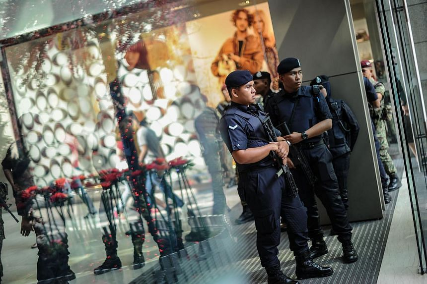 Police stand guard before the arrival of prime minister Najib Razak during a joint police-army exercise at a shopping mall in Kuala Lumpur, on Feb 22, 2016.