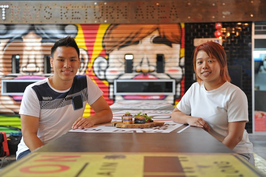 Mr Sean Wong and Ms Gee Jia Xin (both above) serve food that comes in layers.