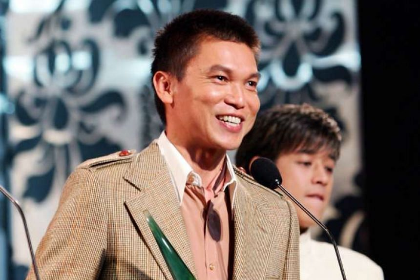 Xie Shaoguang winning the Best Actor award at the annual Star Awards in 2004.