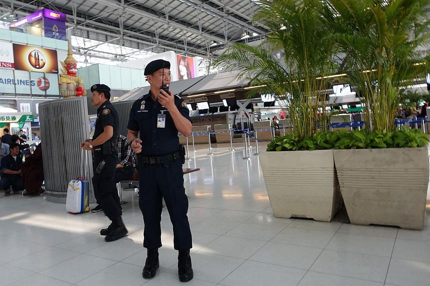 A security officer keeps watch at Suvarnabhumi Airport in Thailand, on March 25, 2016.