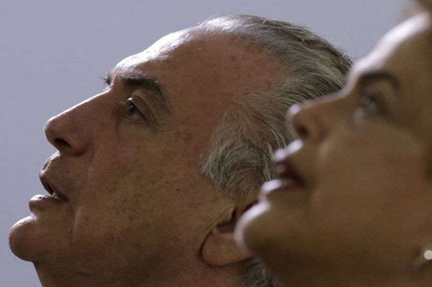Brazil's President Dilma Rousseff (right) and Vice President Michel Temer listen to Brazil's national anthem before an annual lunch with general officers in Brasilia, Brazil, on Dec 16, 2015.