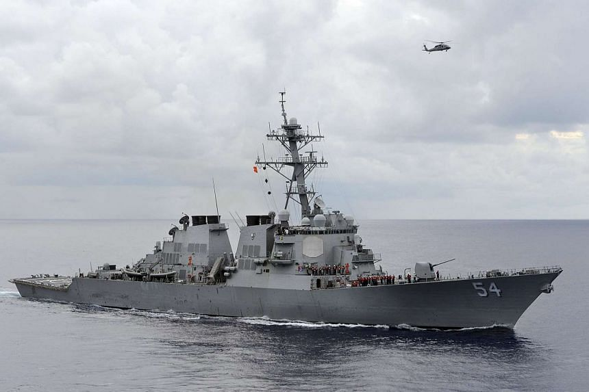 A handout photo of the US Navy guided-missile destroyer USS Curtis Wilbur, which sailed with 12 nautical miles of an island claimed by China in the South China Sea on Jan 30, 2016.