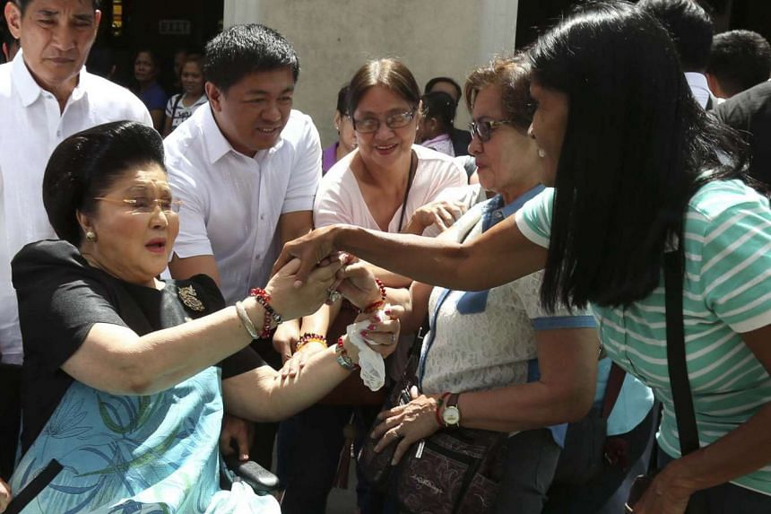Ferdinand Marcos and his jet-setting wife Imelda (above) were accused of massively enriching themselves during their years in power while the country sank deeper into poverty.