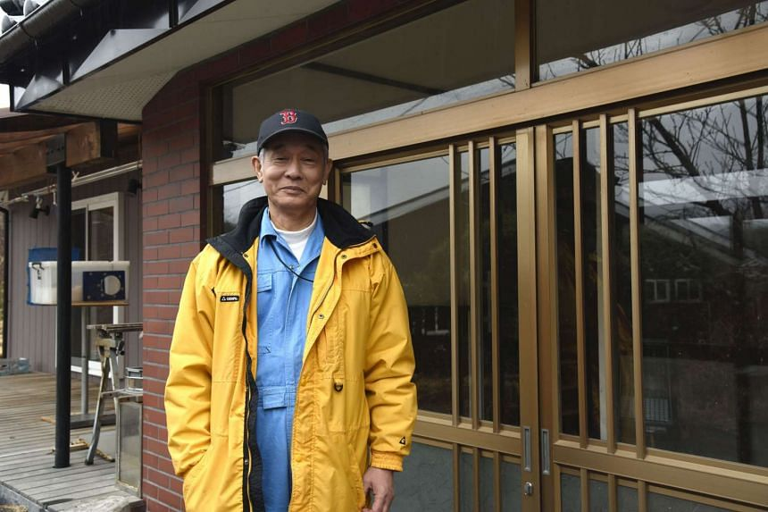 Mr Nobuyoshi Ito, 72, an IT engineer-turned-farmer, stands outside his office.