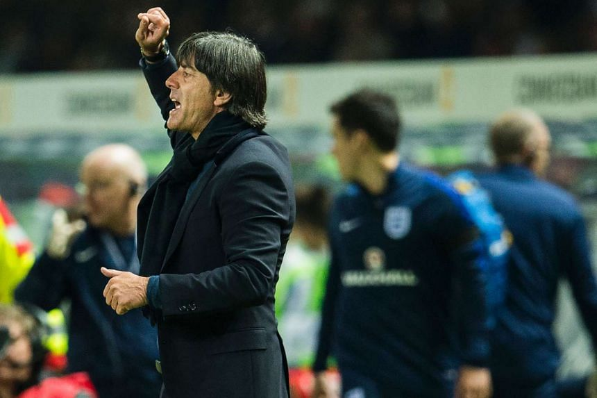 Germany's head coach Joachim Loew gestures during the friendly football match between Germany and England in Berlin on March 26, 2016.