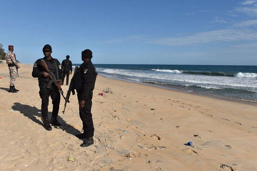 Police officers of the Research and Assistance Police stand on the beach in Grand-Bassam on March 15, 2016, a day after a jihadist attack killed 18 people in the resort town.