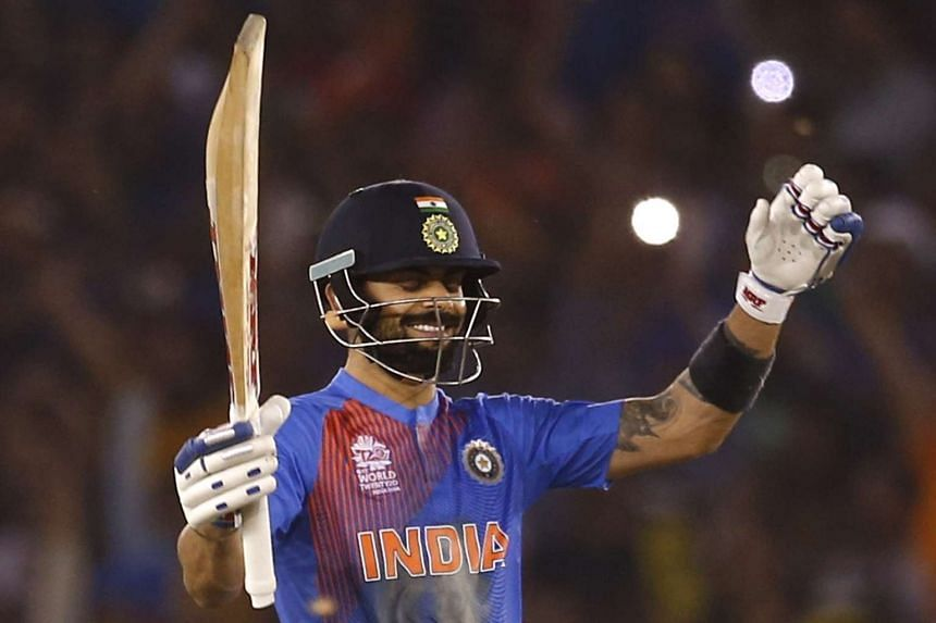 India's Virat Kohli celebrates after winning their match at the World Twenty20 cricket tournament in Mohali, India on March 27, 2016.
