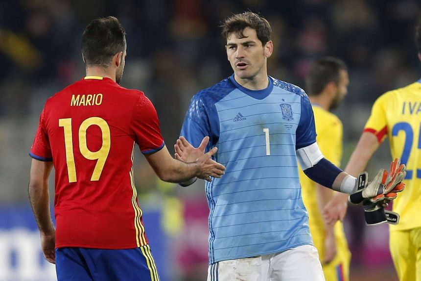 Spain's goalkeeper Iker Casillas (right) cheers up his teammate Mario Perez (left) at the end of the friendly soccer game between Romania and Spain, held at Cluj Arena stadium in Cluj city, 450 Km north-west from Bucharest, Romania, on March 27, 2016
