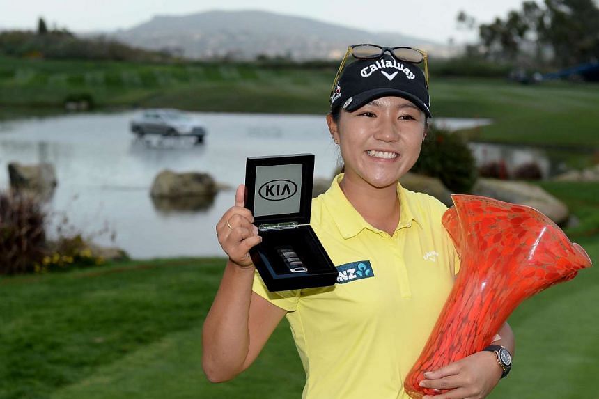 Lydia Ko of New Zealand holds the winner's trophy during the KIA Classic.