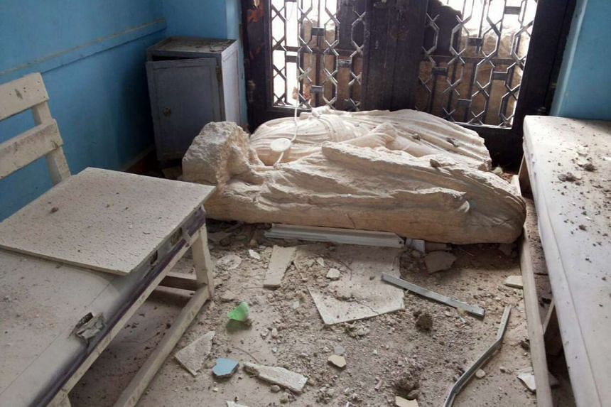 A photo released by the official Syrian Arab News Agency (SANA) on March 27, 2016 shows a damaged statue at the national museum of Palmyra, Syria.