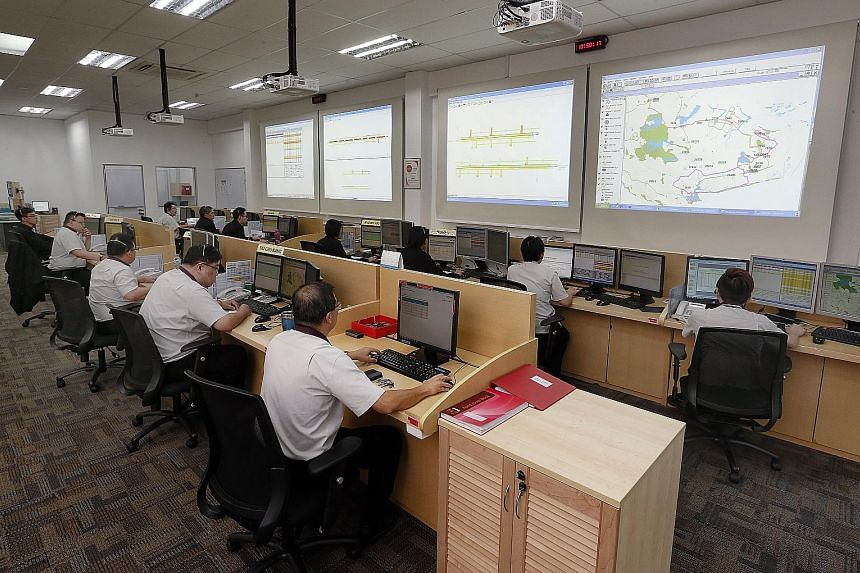 Bus service controllers at SBS Transit's operations control centre. SBS, which has a fleet of more than 3,000 buses and close to 260 bus services, currently has 70 service controllers, but expects the number to go up to about a hundred in the next tw