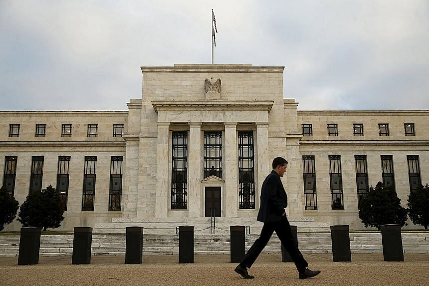 The US Federal Reserve building in Washington. Traders will likely keep watch on Fed chair Janet Yellen's speech at an event hosted by the Economic Club of New York tomorrow for possible clues to the timing of the next US rate hike.
