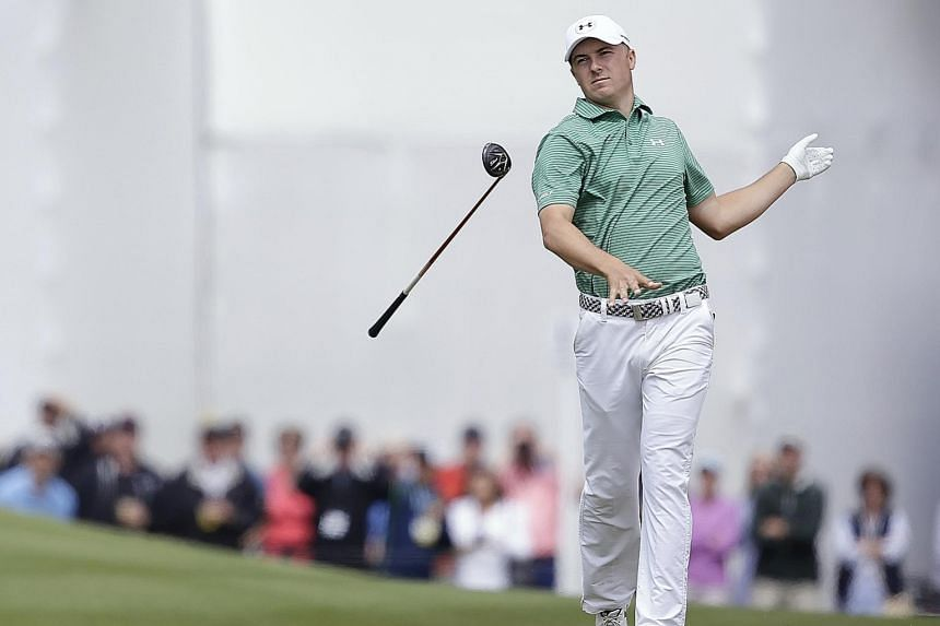 (Above) American Jordan Spieth flinging his club away after losing to South African Louis Oosthuizen in round four of the WGC-Dell Matchplay at the Austin Country Club. (Left) Jason Day celebrating his quarter-final victory over Brooks Koepka with hi