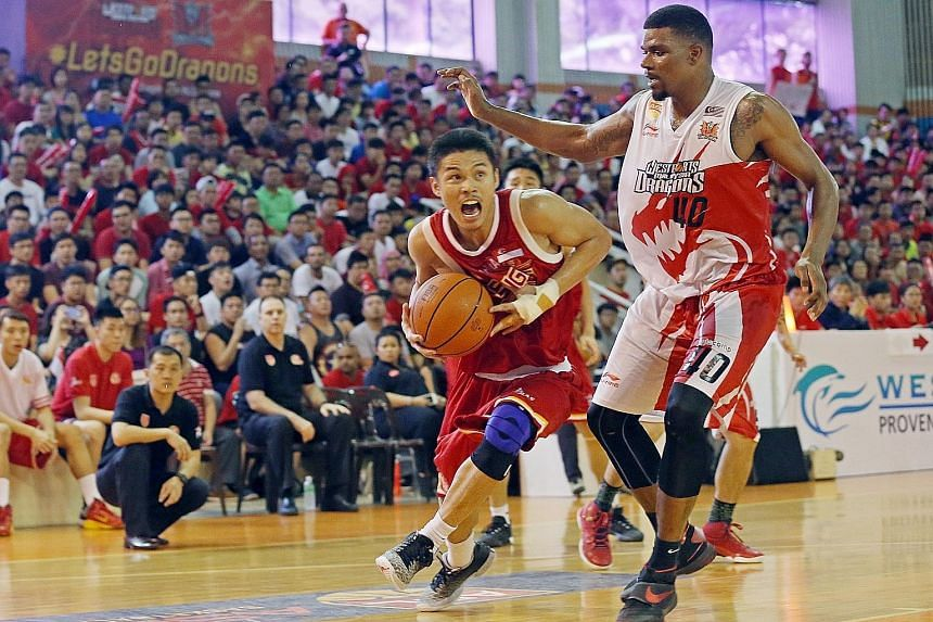 Slingers' Kris Rosales driving past Dragons' Calvin Godfrey in Game 5 of the Asean Basketball League Finals. While lacking stature and financial power, the eight-year-old ABL has much growth potential.