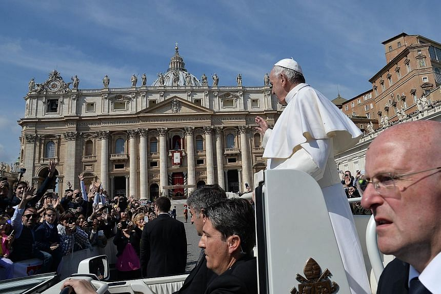 Pope Francis greeting the crowd from the popemobile after the Easter Sunday Mass in St Peter's Square yesterday.