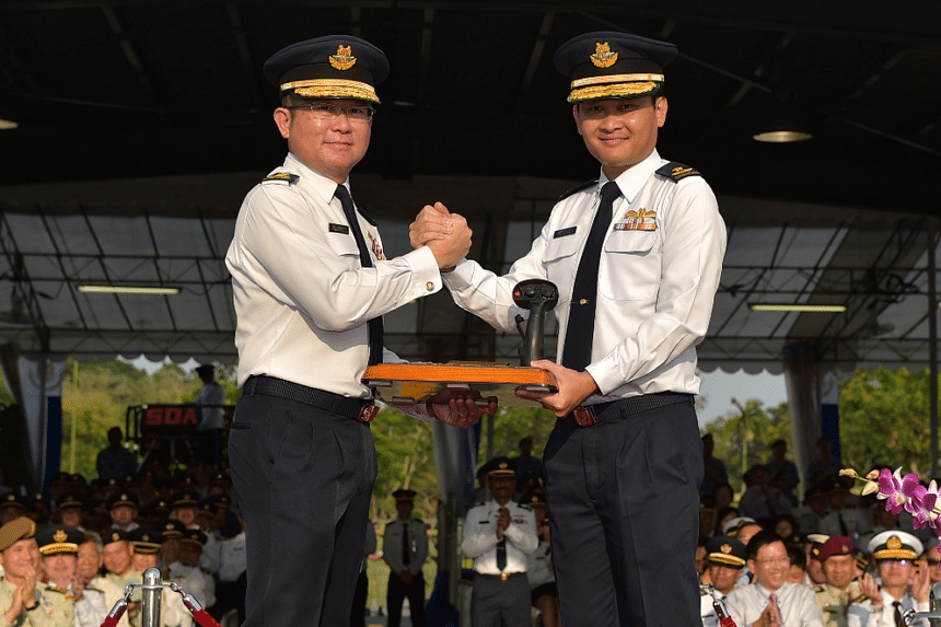 Outgoing Chief of Air Force Major-General (MG) Hoo Cher Mou (left) handing over the command symbol to Incoming Chief of Air Force Brigadier-General (BG) Mervyn Tan Wei Ming (right) at the Change of Command Parade held at Tengah Air Base.