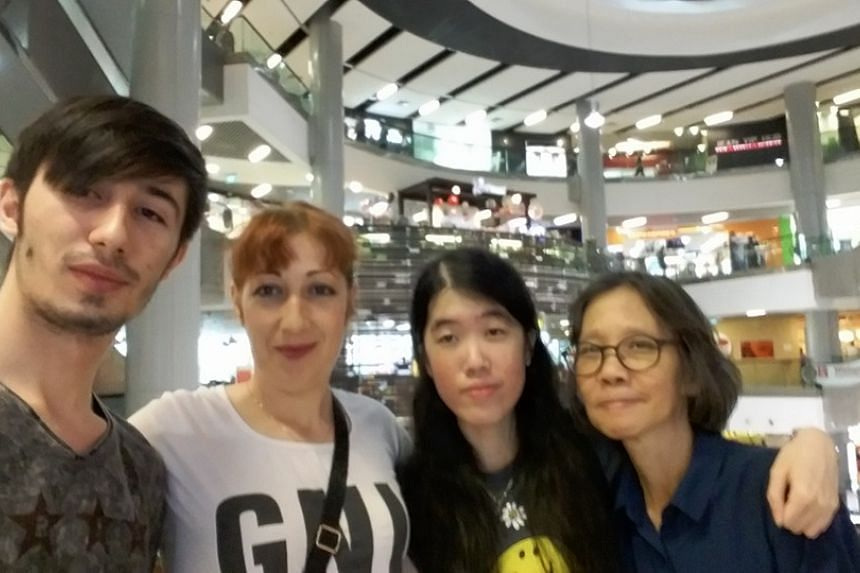 Singaporean Cheryl Yap, her boyfriend Alexandru Donea and their mothers at a shopping mall in Singapore.