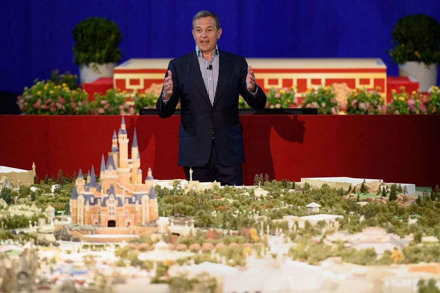 Walt Disney Company chairman and CEO Bob Iger speaking in front of a model of the new Shanghai Disney Resort during a press event in Shanghai.