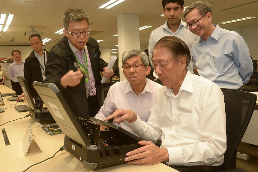 DPM and Coordinating Minister for National Security Teo Chee Hean (right, seated) and MCI Minister Dr Yaacob Ibrahim (second from right), at the Cyber Security Agency of Singapore (CSA) first multi-sector exercise, Exercise Cyber Star 2016, on March