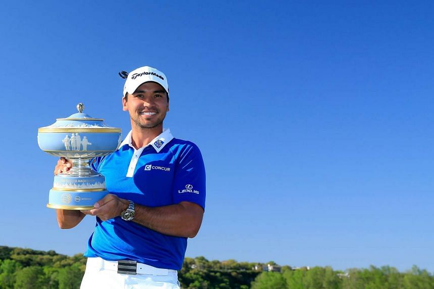 Golfer Jason Day of Australia poses with the Walter Hagen Cup, on March 27, 2016.