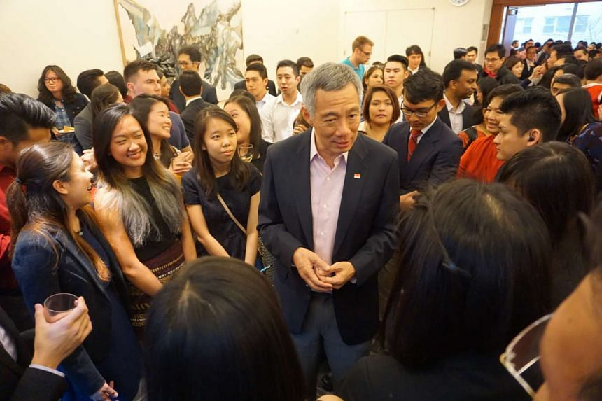 PM Lee Hsien Loong chatting and taking photos with the crowd on Sunday (March 27) at a reception in New York for Singaporeans living in the US.
