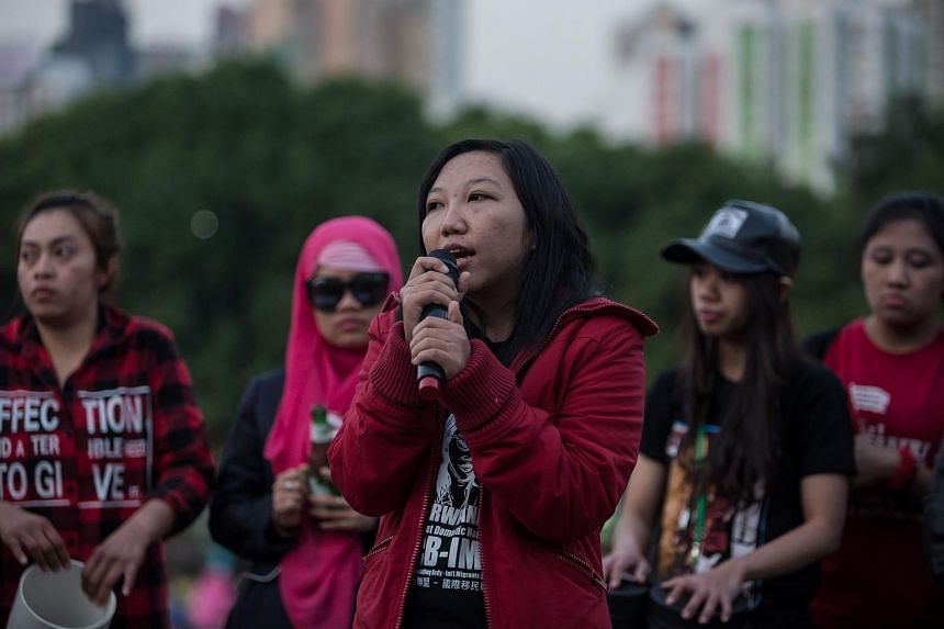 Former Indonesian maid Erwiana Sulistyaningsih (centre) speaks during an event in Hong Kong, on March 27, 2016.