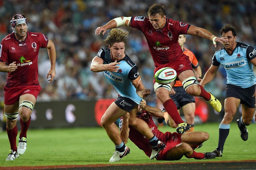 Waratahs captain Michael Hooper (second from left) getting tackled by Reds' Jake Schatz (second from right).